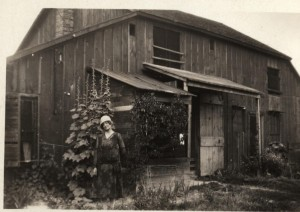 Agnes Inglis in front of Inglis Barn