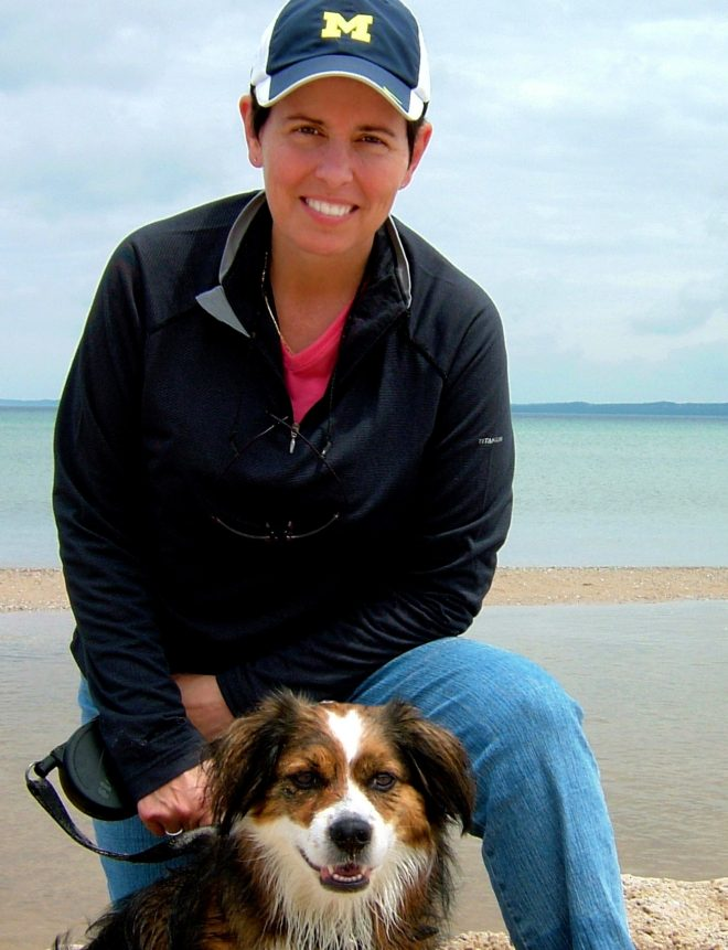 Elizabeth LaPorte with Sadie on Lake Michigan