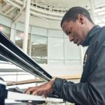 Self-taught pianist and Patient Services Assistant Errick Thomas gives up his lunch hour to play the piano for patients in the Frankel Cardiovascular Center.